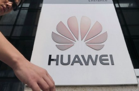 A man walks past a Huawei company logo outside the entrance of a Huawei office in Wuhan, Hubei province. File photo: REUTERS
