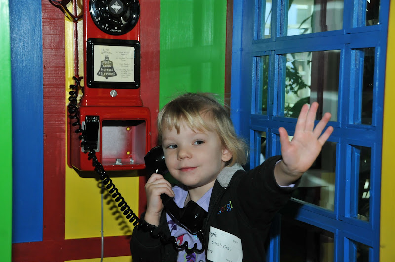 Photo: Sarah simultaneously makes a call and waves from Building 43