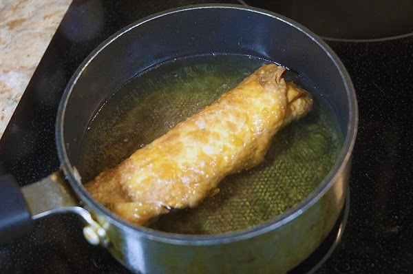 Deep fry until the outside is golden brown, about 3 to 4 minutes.