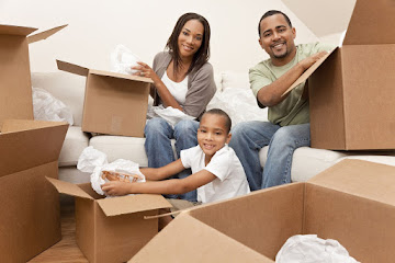 family  packing boxes before moving house