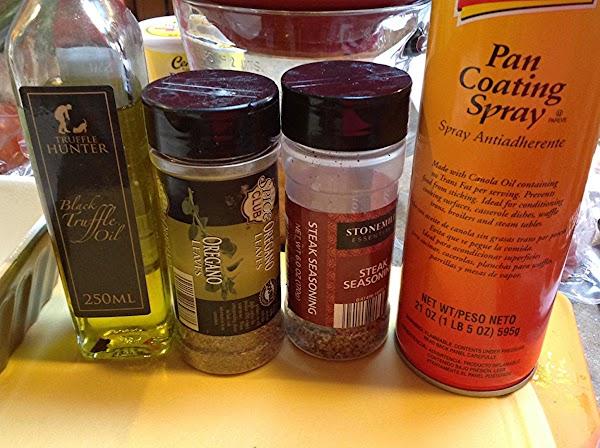 Add in the truffle oil, oregano & steak seasoning. Then toss to coat evenly...