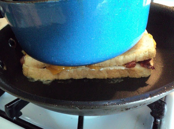 I used a heavy saucepan to place on top of the sandwich when grilling...