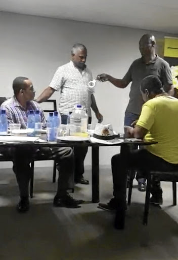 Video footage shows Richard Mdakane resisting arrest at a meeting.