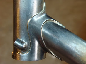 Photo: After I brazed on these bullet shaped cable stops, I machined off that protruting bit of head tube.