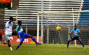 Photo: Abduali Baggie takes the shot [Training game against u-20 National team, ahead of Leone Stars v Seychelles Game in Freetown on 19 July 2014 (Pic: Darren McKinstry)]