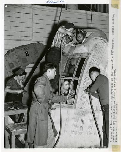 Wartime Workers Practicing Riveting on the Nose of a PBY Bomber Aircraft