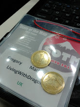Photo: SotM12 Conference badge and lunch 'way' coins.