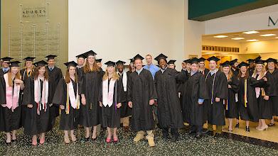 "Photo: ""McDaniel Rocks"" cheered members of the Class of 2013 just before processing into Gill Center for the Senior Investiture & Honors Convocation."