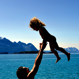 Father and daughter by Silje Ramsvatn - Novices Only Portraits & People ( playing, mountain, blue sky, sea, beach )