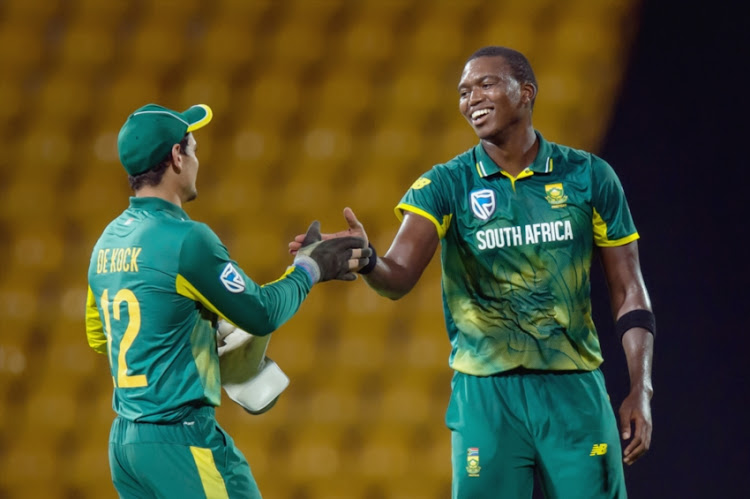 Lungi Ngidi (R) of South Africa celebrates the wicket of Dhanajaya De Silva of Sri Lanka (not in picture) with Quinton de Kock (L) Captain of South Africa during the 4th ODI between Sri Lanka and South Africa at Pallekele International Cricket Stadium.