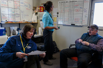 Photo: Logistics coordinators Teri Paton & Debbie Miller work with chief pilot Bert Hanson to coordinate flights at Unalakleet on Sunday, March 9, during the Iditarod Sled Dog Race 2014.PHOTO (c) BY JEFF SCHULTZ/Schultzphoto.com -- REPRODUCTION PROHIBITED WITHOUT PERMISSION