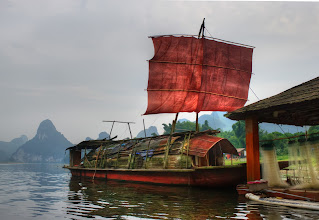 Photo: Chinese Pirates on the Li River  One evening, my boat driver was speeding down the Li River as dusk was approaching. Every bend held new secrets as we wound our way further from civilization. I had a bag full of snacks to my left side and my DSLR to my right. Sitting out on the front of the boat, I had a full view of everything that was coming at me, so it was pretty amazing.  Just before we got to the turn-around spot, we came across this old ship. Part of me wanted to go inside to explore a little bit… the other part of me was a bit freaked out. Since I was new to this part of the 'verse, I thought there could be Reavers inside.  from the blog www.stuckincustoms.com