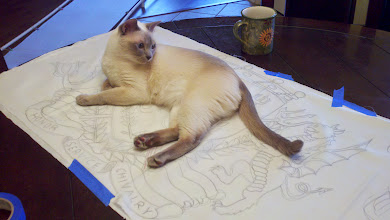 Photo: Chaucer, helping. As always. He does make a good fabric weight...
