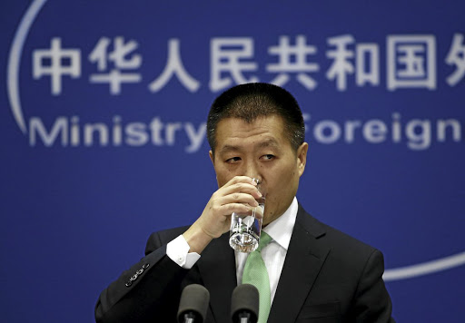 Trading words: Chinese Foreign Ministry spokesman Lu Ywe Kang said China would respond to US tariffs, while state media said the US's economic war was an attempt to hold back China's development. Picture: REUTERS