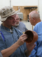 Photo: Tom Ankrum discusses a pair of nicely -formed cherry bowls...