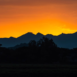 What's Behind by Ynon Francisco - Landscapes Mountains & Hills ( orange, gold, sunrise, sunset, silhouette, mountain range )