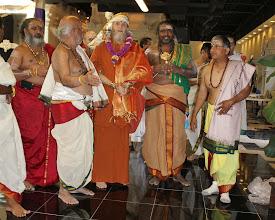 Photo: Thangarathna Bhattar explains the program to Satgur Bodhinatha - Sivacharya Bhairavasundaram Gurukkal and Temple Religious Committee chairman Ramesh Natarajan to the right