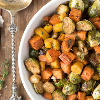 Herb Roasted Garlic Brussels Sprouts Sweet Potatoes and Carrots.