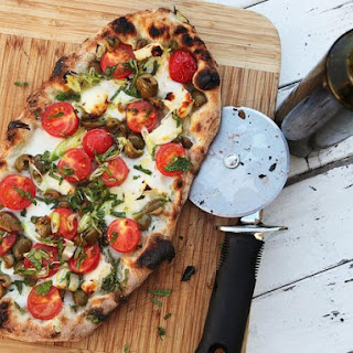 Pizza With Cherry Tomatoes, Halloumi, Olives, and Mint