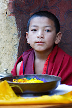 Photo: Young monk selling good luck bracelets at Jangsarpey Lhakhang, Bhutan