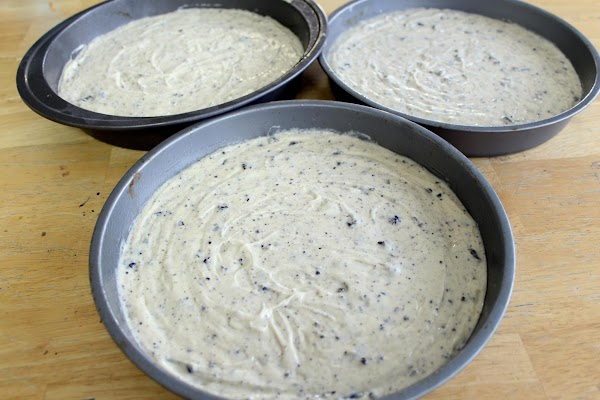 Pour evenly into prepared pans making sure to have an even amount of batter...