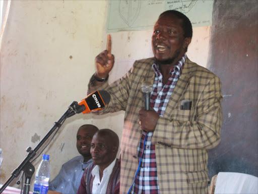 ODM Treasurer Kitutu Masaba MP Timothy Bosire speaks at Morako Primary School.
