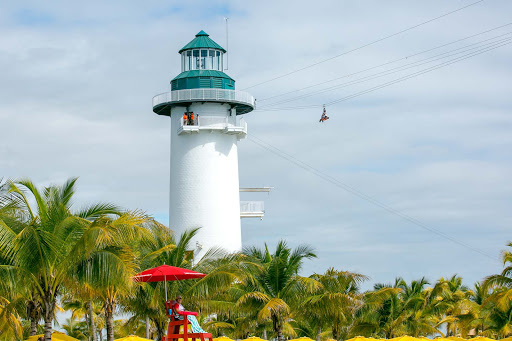 A zipliner takes off from the Flighthouse at Harvest Caye in Belize.