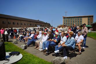 Photo: group watching salmon bake