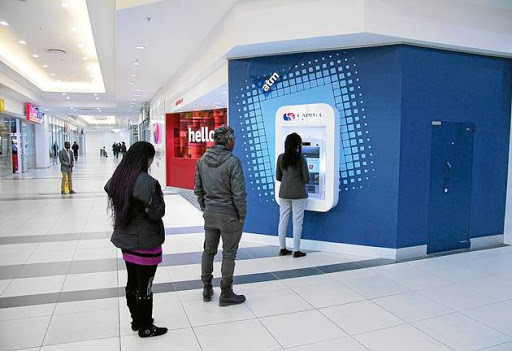 Customers queue at a Capitec bank ATM.   Picture: SUPPLIED