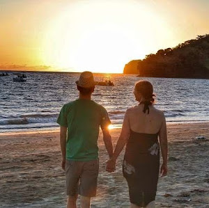 Madagascar proposal Man and Woman walking together on beach during sunset