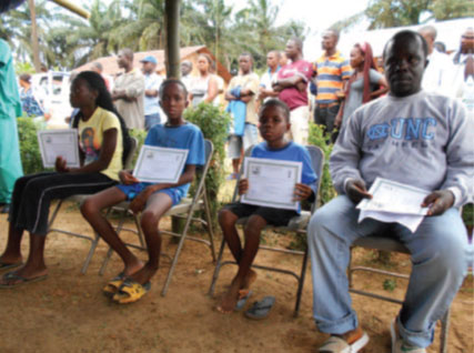Ebola survivors, three orphans and their uncle, receiving Certificate of Medical Clearance as part of the Firestone Ebola Survivor Reintegration Program - Firestone District, Liberia, 2014