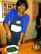 Photo: Urmi cutting steamed mixed chive cake