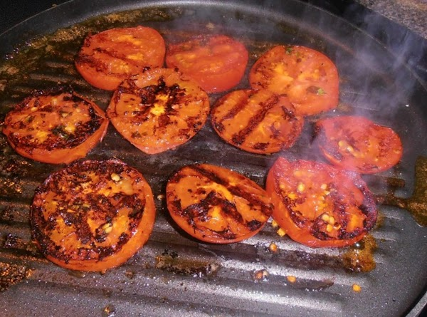 Brush evoo mixture on tomatoes. Grill tomatoes on hot grill pan for 2-3 minutes...