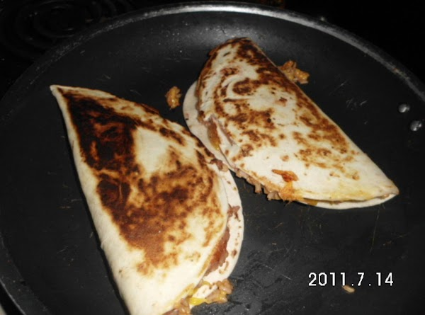 Fold in half and brown both sides of tortilla in a skillet over med-high...