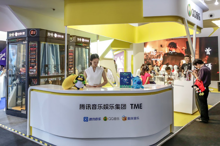 Visitors at Tencent Music Entertainment's booth at the Beijing Music and Life Show in May 2017. Picture: REUTERS