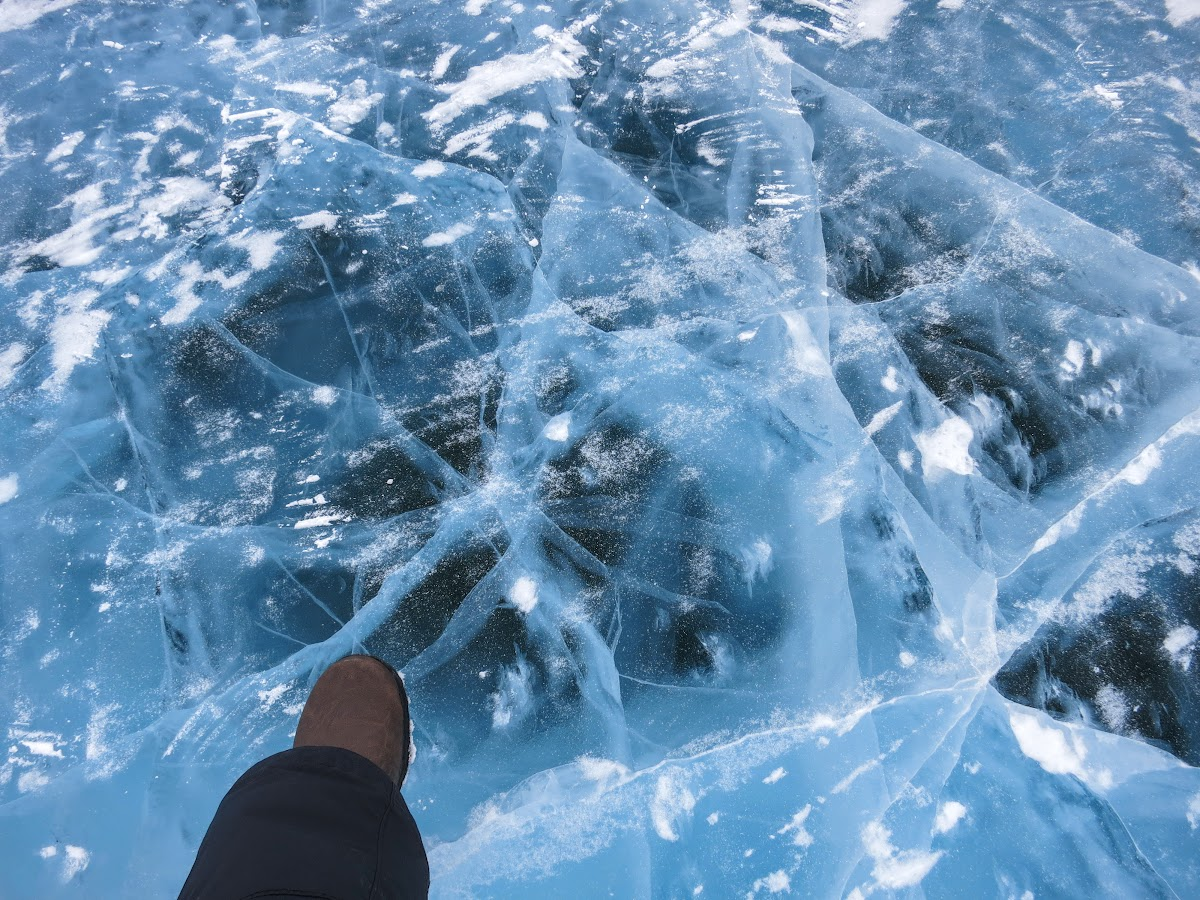 Standing over 3 feet of solid river ice