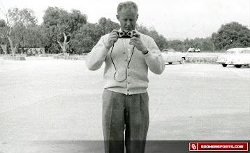 Photo: Wilkinson taking photos during a trip the 1957 trip to Mexico City.