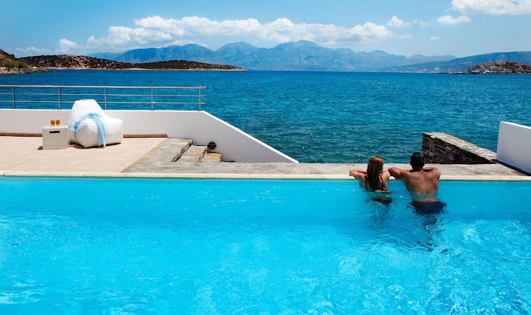 Laidback living and island style at Minos Beach art hotel, Greece.