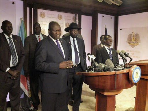 South Sudan First Vice President Riek Machar (L), flanked by South Sudan President Salva Kiir (C) other government officials, addresses a news conference at the Presidential State House in Juba, South Sudan, July 8, 2016. REUTERS/Stringer