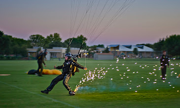 Photo: The Golden Knights are Bad Ass  This was taken during an evening demonstration on the night before OpenCamp began. It was an unforgettable night with the Knights! After falling a few miles from the sky, the skydivers would open up their chutes & pyrotechnics and let loose. Since I had jumped with them the day before, they let me get up close on the landing to get some tight shots.   - from Trey Ratcliff at www.stuckincustoms.com
