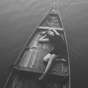 Girl on river by Thomas Jeppesen - Black & White Portraits & People ( water, girl, female, woman, vietnamese, vietnam, boat, sensual, river )
