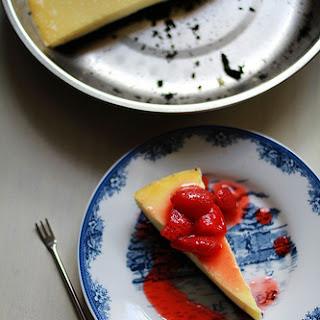 White Chocolate Cheesecake with Oreo Crust and Strawberry Compote