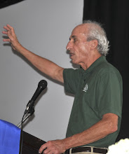 Photo: Denny Riley of the San Francisco chapter encourages everyone to come to next year's convention in the Bay Area