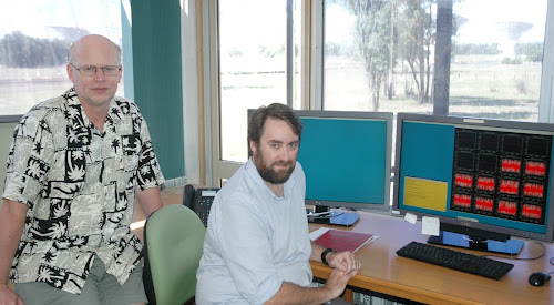 STILL DISCOVERING: Australia Telescope Compact Array electronics group leader Peter Mirtschin and senior systems scientist Jamie Stevens at the Culgoora facility - you can read a description of what is on the monitor next to Mr Stevens in The Courier, Tuesday, April 11.