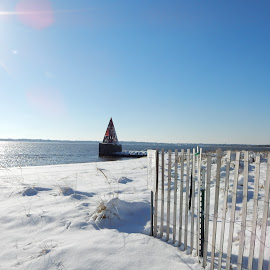 Snow Cone on the Reservation by Kristine Nicholas - Novices Only Landscapes ( dunes, icy, buoy, waterscape, dune, fences, ocean, beach, landscape, sun, grasses, fencing, cold, ice, snow, water, sand, grass, sea, snowy, seascape, sunlight, rays, fence, winter, triangle, marker, sand dunes, reservation, waterway,  )