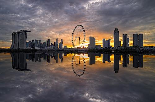 by Gordon Koh - City,  Street & Park  Skylines ( clouds, shenton way, reflection, skyline, riverfront, suntec city, cityscape, travel, singapore, city, financial district, skyscraper, sunset, asia, buildings, jubliee bridge, singapore flyer, long exposure, waterfront,  )