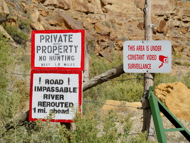 Landowner's stupid (and untrue) signs trying to scare the public away from a public road