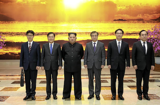 North Korean leader Kim Jong-un, third left, poses with the South Korean delegation led by Chung Eui-yong, head of the presidential National Security Office, to Kim's left, in Pyongyang, North Korea on March 6 2018. Picture: THE PRESIDENTIAL BLUE HOUSE/YONHAP VIA REUTERS