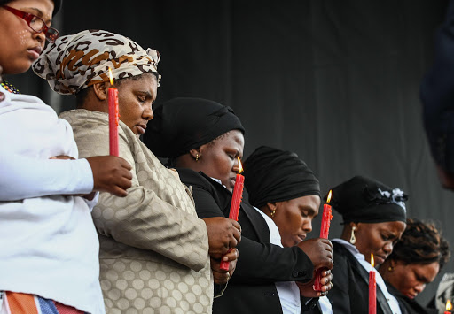 16 August 2014 Miners gathered at the Kopie to commemorate the second anniversary since the police killed the 34 miners during the strike in Marikana. The Marikana widows carried candles during the event. File photo