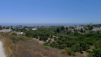 Photo: Looking east across market gardens and orchards towards the sea from above Nerja